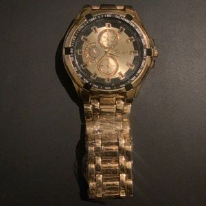 NWOT men's gold tone and black fashion watch